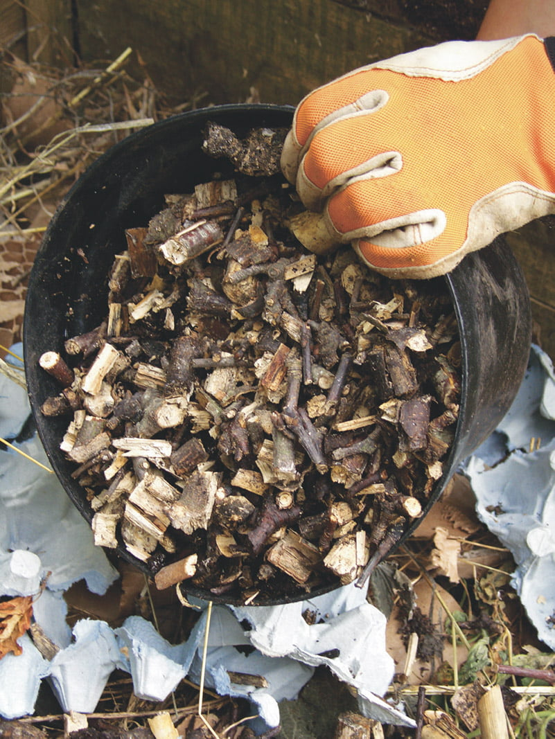 adding dry material to compost