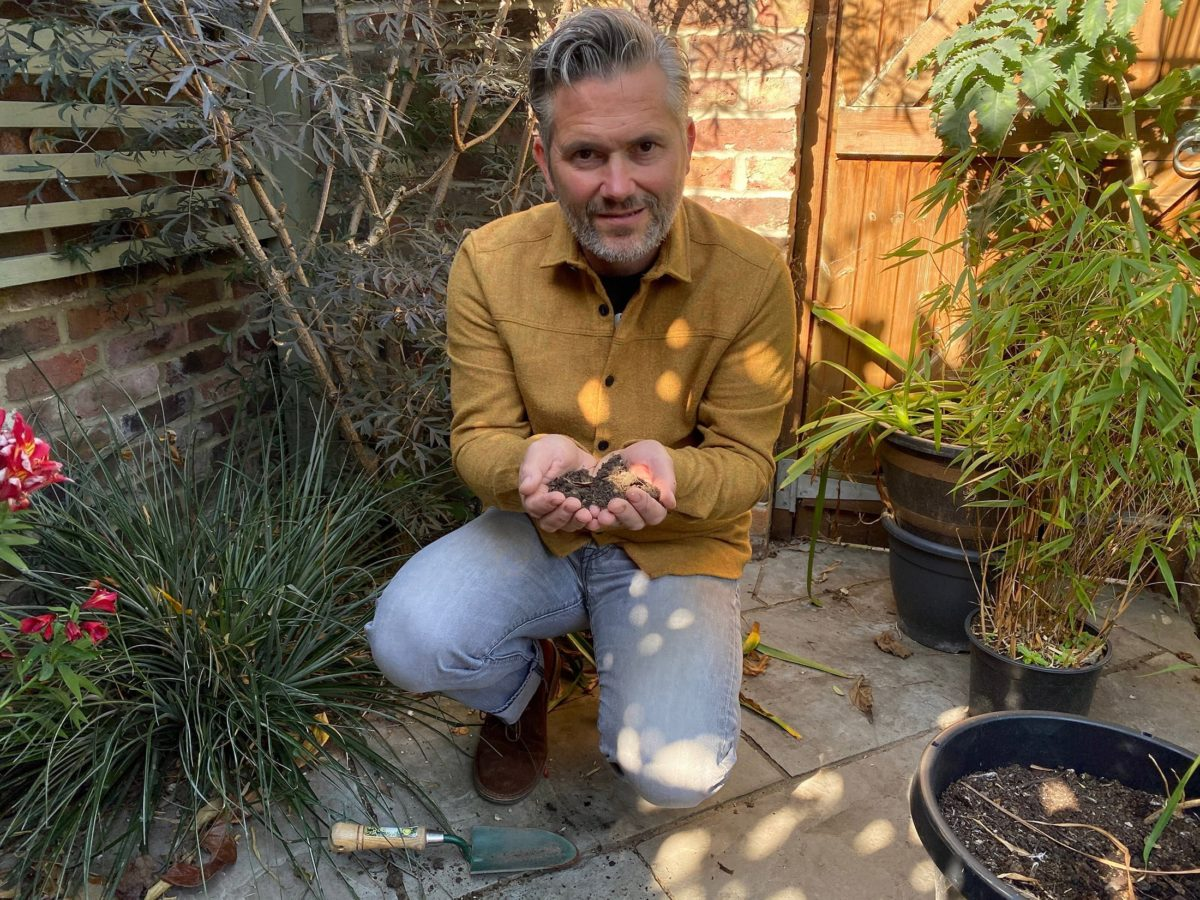 Martyn Cox with handful of soil