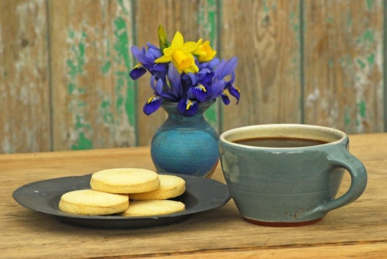 Coffee, biscuits and flowers on a table