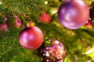 close up of decorated Christmas tree with pink baubles