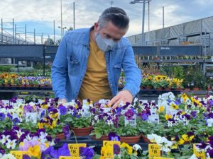 Martyn Cox looking at plants in garden centre