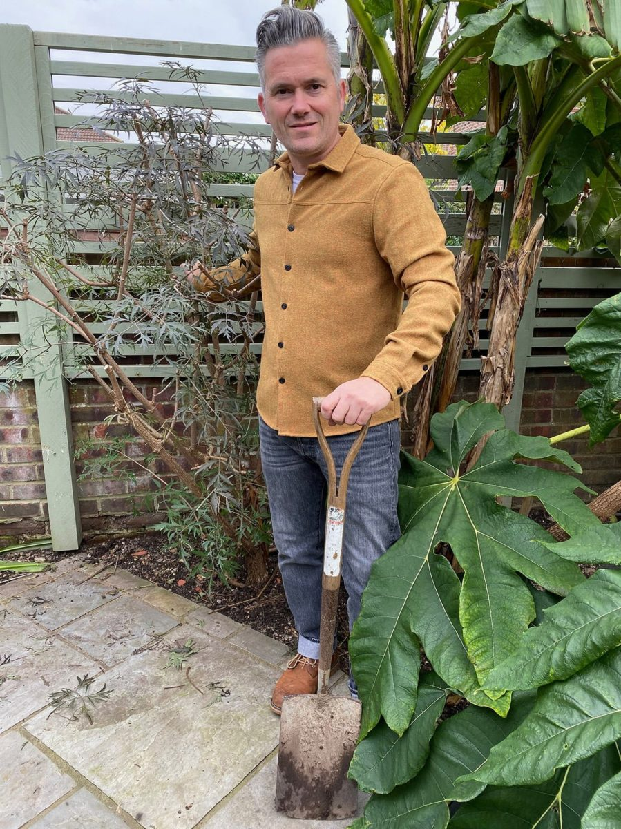 Martyn Cox in garden with cut leaf black elder and Japanese banana