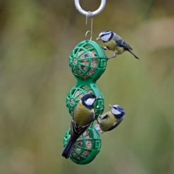 Jacobi Jayne hanging ball feeder with two blue tits and one coal tit feeding