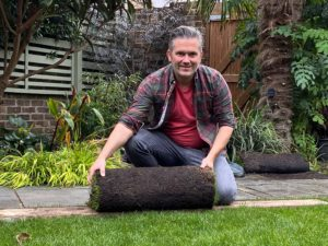 Martyn Cox with roll of turf
