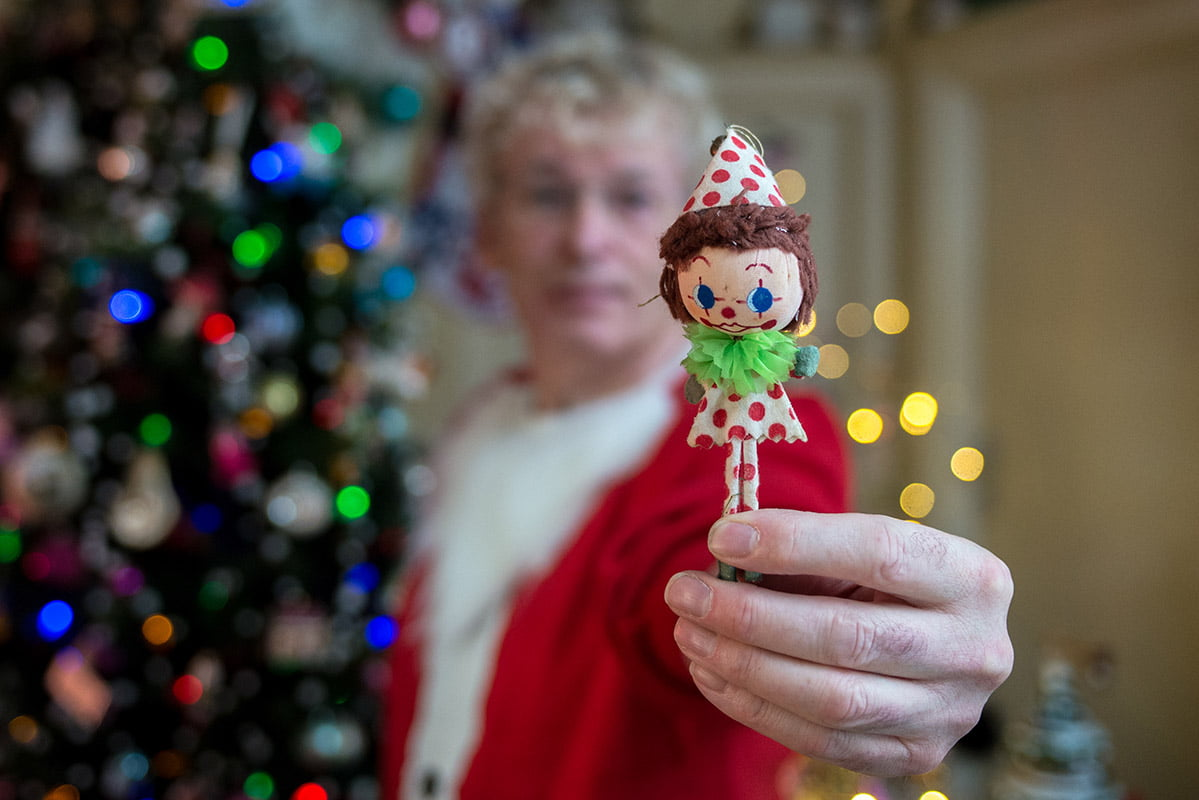 Geoff Stonebanks holding Christmas decoration made by his grandmother