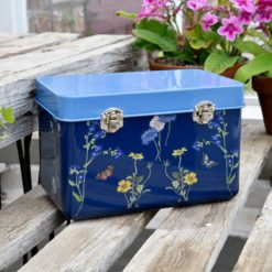 Burgon & Ball British Meadow Collection Seed Tin on outdoor bench with potted plants