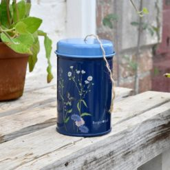 Burgon & Ball British Meadow Collection Twine Tin on outdoor bench