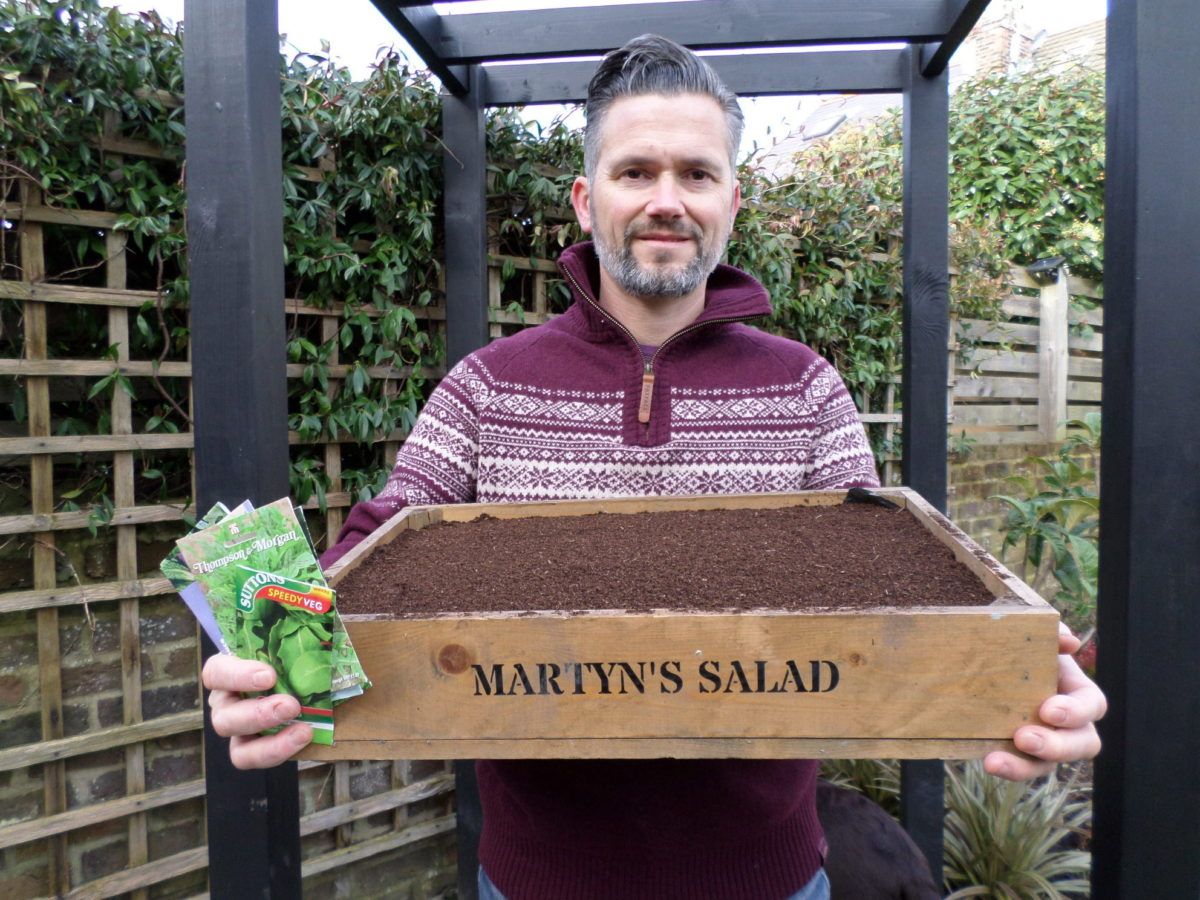 Martyn Cox with tray of seedlings