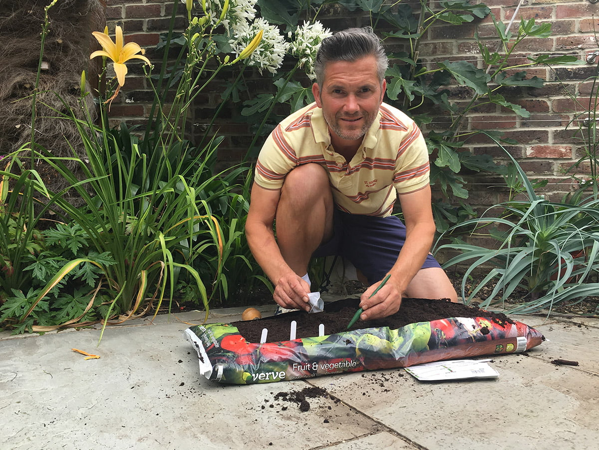 Martyn Cox sowing seeds in grow bag