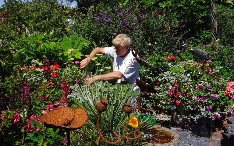 Geoff Stonebanks working in his Driftwood garden