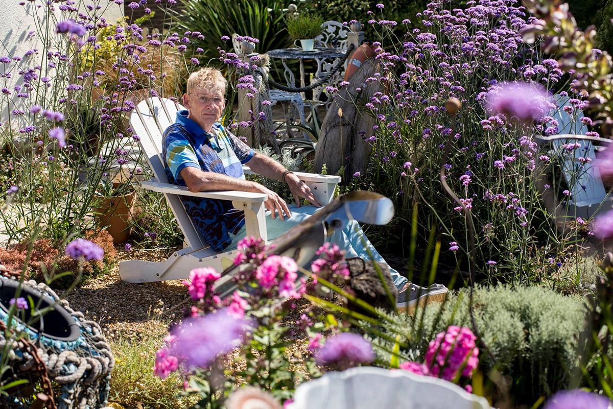 Geoff Stonebanks sitting in his garden at Driftwood