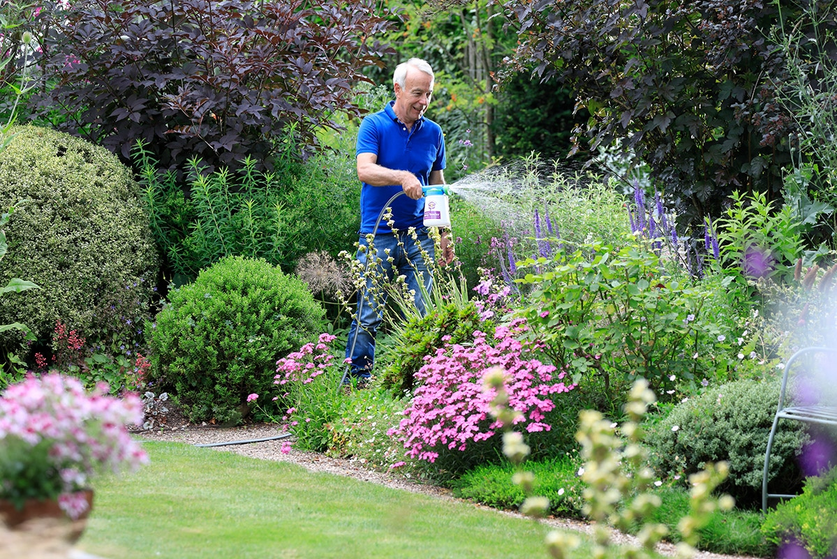 Richard using easy feeder to feed plants with flower power