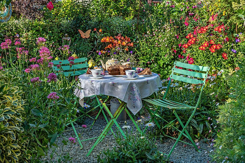 Green table and chairs at Driftwood Garden