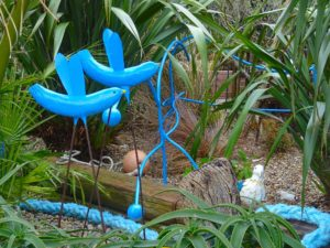 Blue birds and fence at Driftwood garden
